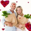 Happy couple carrying paper grocery bags — Stock Photo #64820589