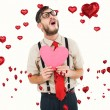 Hipster crying and holding heart card — Stock Photo #64822347