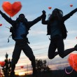 Silhouette couple jumping against the sky — Stock Photo #64822769