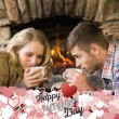 Romantic couple drinking tea in front of lit — Stock Photo #64822773