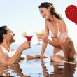 Couple having cocktails in the pool — Stock Photo #64823019
