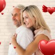 Affectionate couple standing and hugging — Stock Photo #64823025