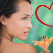 Beautiful nude brunette smelling lily — Stock Photo #64823829