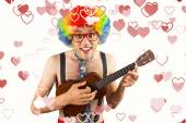 Geeky hipster in afro rainbow wig playing guitar — Stock Photo
