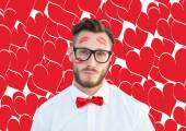 Geeky hipster with kisses on face — Stock Photo