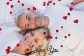 High angle portrait of a mature couple lying — Stock Photo