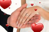 Cropped image of newly wed couple holding hands — Stock Photo