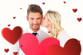 Attractive couple holding red heart — Stock Photo