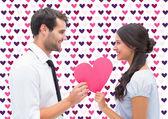 Brunette giving boyfriend her heart — Stock Photo