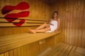 Calm brunette relaxing in a sauna — Stock Photo