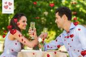 Couple with champagne flutes sitting — Stock Photo