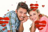 Attractive young couple lying and smiling — Stock Photo