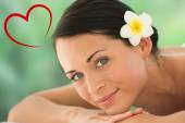 Beautiful brunette relaxing on massage table — Stock Photo