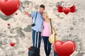 Attractive couple ready to go on vacation — Stock Photo