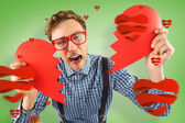 Geeky hipster holding broken heart — Stock Photo
