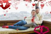 Couple in winter wear with coffee cups agains — Stock Photo