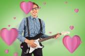 Geeky hipster playing the guitar — Stock Photo