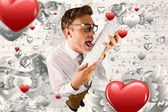 Geeky businessman licking his keyboard — Stock Photo