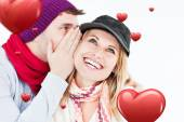 Man telling secret to girlfriend — Stock Photo