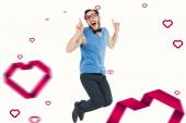 Geeky hipster jumping and smiling — Stock Photo