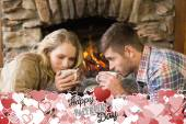 Romantic couple drinking tea in front of lit — Stock Photo