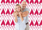 Happy couple standing and hugging — Stock Photo