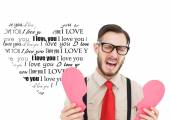 Hipster crying and holding broken heart card — ストック写真
