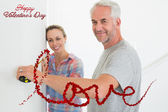 Happy couple making some measurements together — Stock Photo