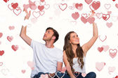 Couple with hands raised — Stock Photo