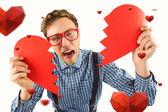 Geeky hipster holding broken heart — Stock Photo