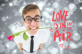 Composite image of romantic geeky hipster — Stock Photo