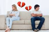Couple sit at the two ends of the couch — Stock Photo
