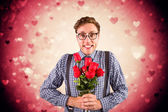 Geeky hipster holding a bunch of roses — Stock Photo