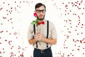Geeky hipster offering rose — Stock Photo