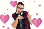 Geeky hipster in sweater vest pointing — Stock Photo