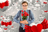 Geeky hipster holding bunch of roses — Stock Photo