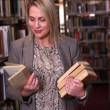 Librarian taking a book off the shelf — Video Stock #65078373