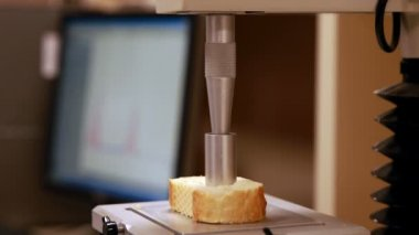 Machine punching hole in piece of bread — Stock Video