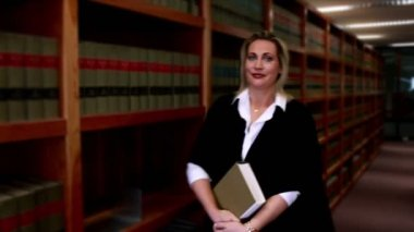 Librarian smiling at the camera — Stock Video