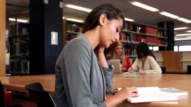 Focused mature students working around a table — Stock Video