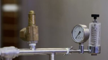 Focus on taps and gauge on vat — Stock Video