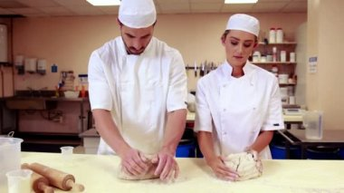 Culinary students kneading dough together — Stock Video