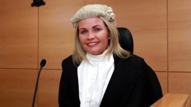 Smiling judge wearing robes and wig — Stock Video