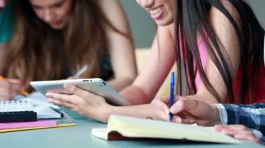 Classmates studying and using tablet pc — Stock Video