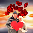 Happy mature couple in winter clothes holding — Stock Photo #65238805