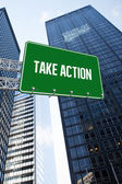 Take action against low angle view of skyscrapers — Stock Photo