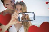 Composite image of valentines couple — Stock Photo