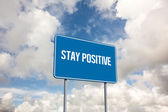 Stay positive against blue sky with white clouds — Stock Photo