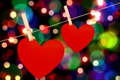 Composite image of hearts hanging on a line — Stock Photo