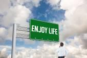 Word enjoy life and thinking businessman — Stock Photo